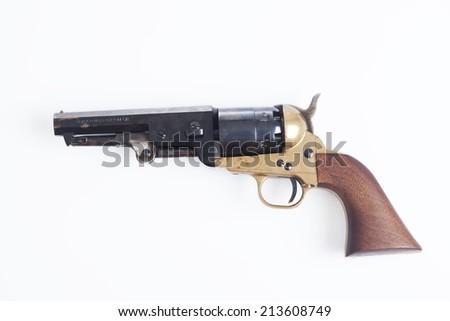 Old revolver on white background  - stock photo