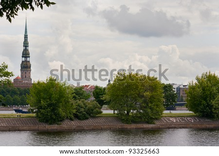 Old Riga view across Daugava river, summertime. St. Peter's church - stock photo