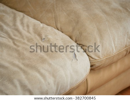 Old ripped sofa - stock photo