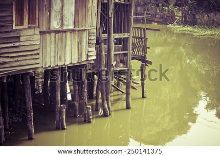 old riverfront house in Thailand, vintage style - stock photo