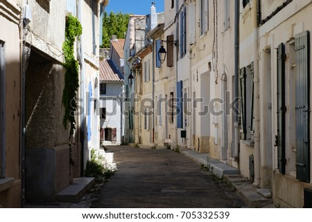 Old road with houses in Arles, France