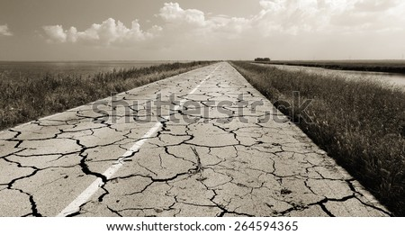 old road with many crack - stock photo