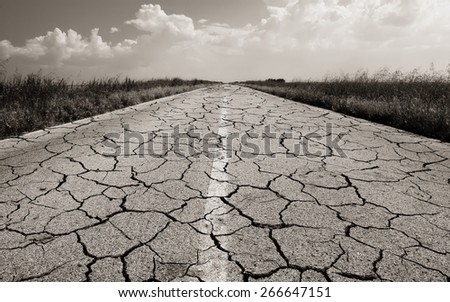 old road with many cracks - stock photo