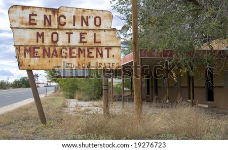 Old roadside motel in a small western town with mis-spelled sign - stock photo