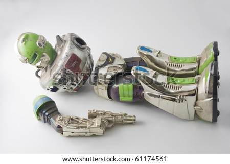 old robot toy broken and damaged - stock photo