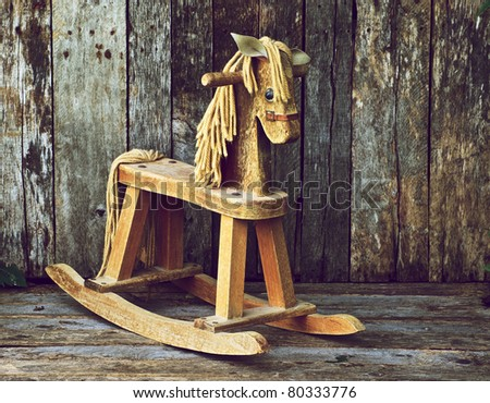 Old rocking horse on a rustic country backdrop. This image is now available in my portfolio, isolated on white. - stock photo