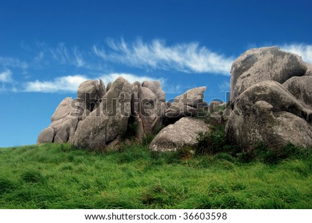 Old rocks on green grass on Brittany in France