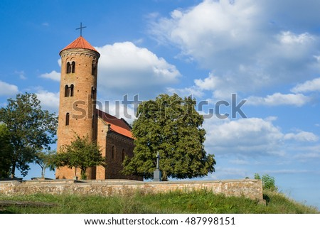 Old romanesque church of saint Giles and saint Giles monument in Inowlodz, Poland