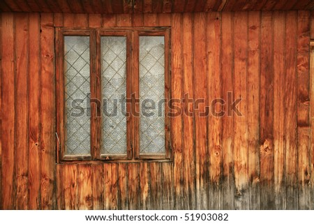Old romanian wooden window with wall texture - stock photo