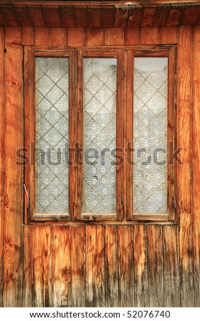 Old romanian wooden window with wall texture. vertical view - stock photo