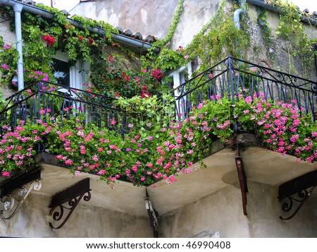 Old Romantic Balcony ful with flower - stock photo
