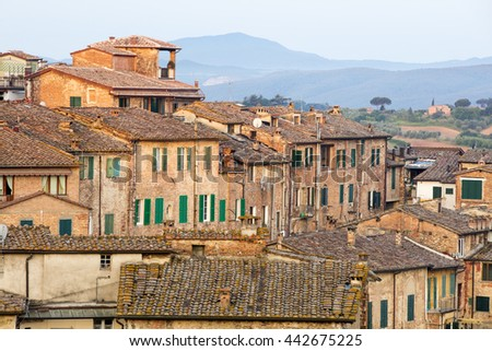 old roof of city buildings in Siena in Italy - stock photo