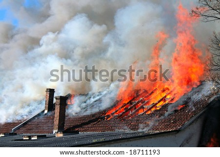Old roof on fire - stock photo