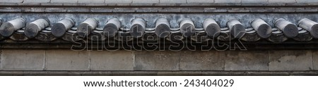 Old roof on wall ( Korea style ) - stock photo
