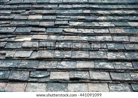 Old roof tiles background. - stock photo