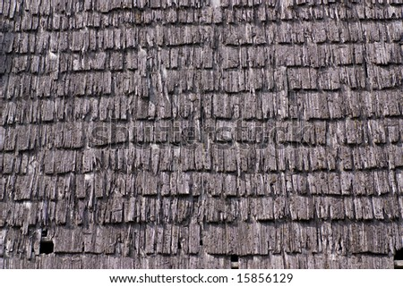 Old roof tiles, made of small wooden planks - stock photo