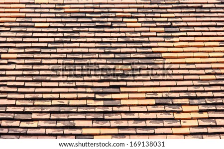 Old roof tiles made of terracotta - stock photo