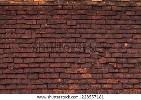 Old roof tiles made of terracotta background. - stock photo