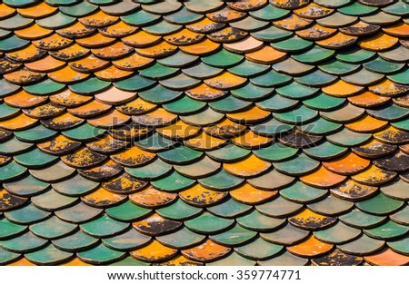 Old Roof tiles of Thai temple - stock photo