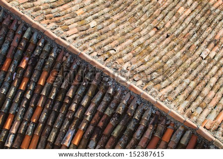 old roof tiles on an old house of a mediterranean village
