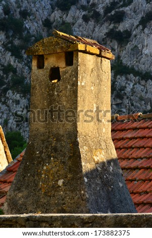 Old roof with chimney on abandoned house - stock photo