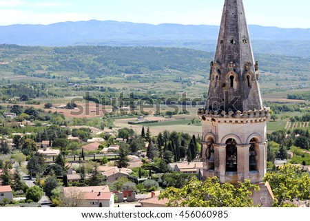 Old roofs and bell tower of typical small village in La Provence, wooden doors, windows, old street lamps, beautiful view, outdoors - stock photo
