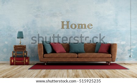 Old room with colorful leather suitcases,sofa ,blue wall and wooden floor - 3d rendering