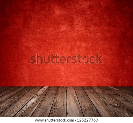 old room with concrete wall and wooden floor, red background - stock photo