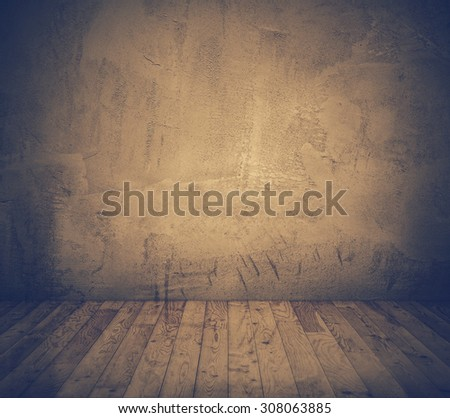 old room with concrete wall and wooden floor, retro filtered, instagram style - stock photo