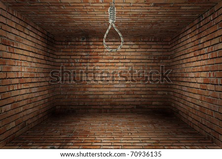 Old room with red brick wall with noose of rope - stock photo