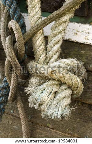 Old rope tied in a knot - stock photo