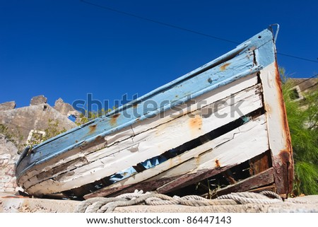 Old rotting wooden fishing boat in fishing village on the Croatian coast