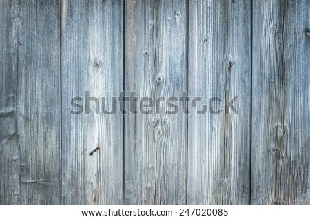 Old rough discolored wood texture (background) - stock photo
