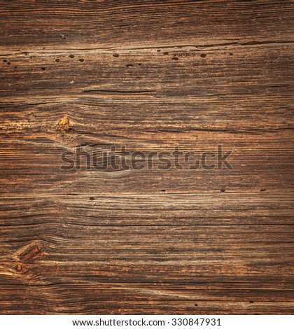 Old rough wooden background with holes - stock photo