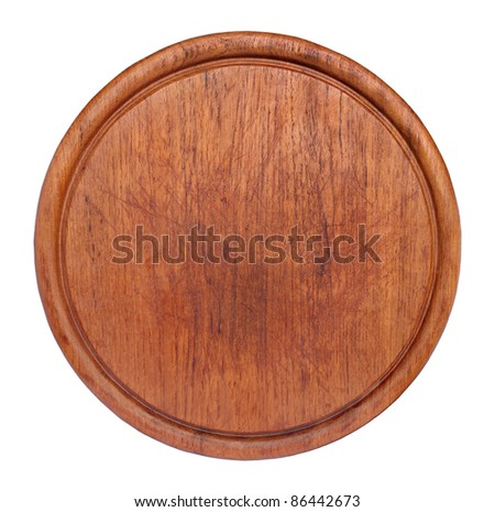 Old round cutting board isolated on white. - stock photo