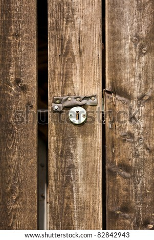 Old round door lock - stock photo