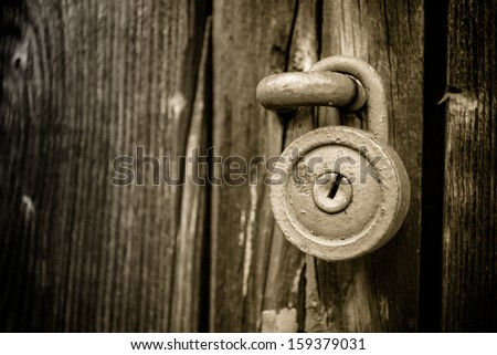 Old round lock - stock photo