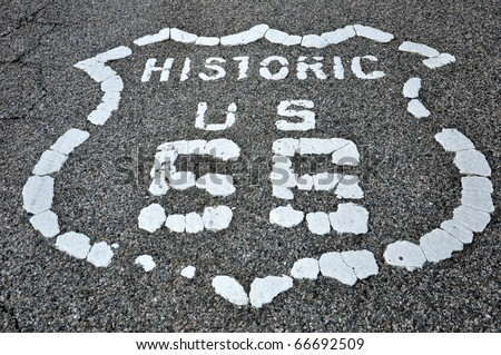 Old route 66 logo painted on asphalt - stock photo
