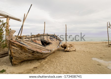 Old row boat on a beach - stock photo