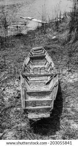 Old rowboat down the reservoir
