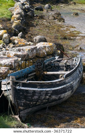 Old rowboat on the beach of Carna in Connemara Ireland on the dry