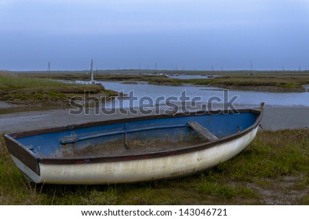 Old rowing boat at Brancaster Norfolk England - stock photo