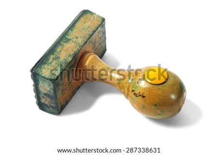 Old rubber stamp isolated on white - stock photo