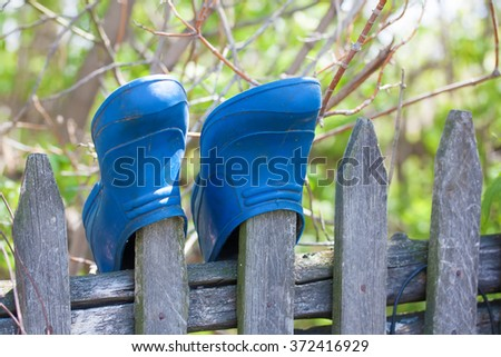 Old rubbers  hanging on the fence. - stock photo