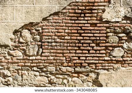 old ruined brick wall - stock photo