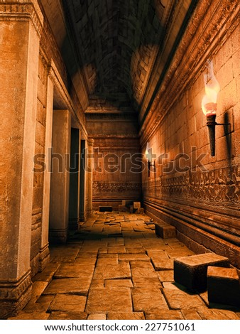 Old ruined corridor lit by torchlight - stock photo