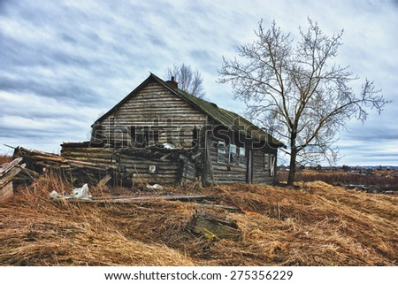 Old ruined farmhouse. - stock photo