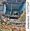 old ruined house destroyed during earthquake - collapsed wall of unsafe house - stock photo