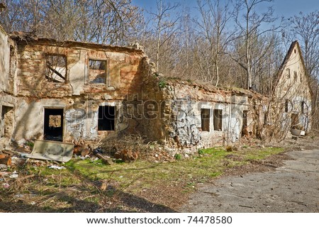 old ruined house more as one hundred years - stock photo