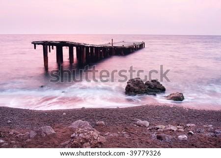 old ruined pier at sunset in the sea. Black sea, Crimea, Ukraine - stock photo